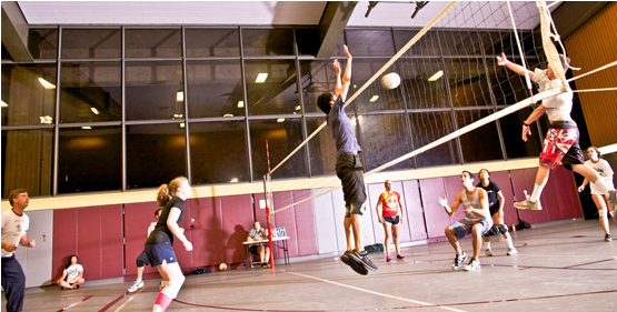 Students playing drop-in volleyball
