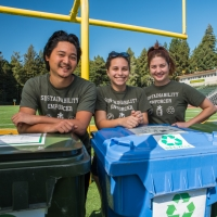 Zero Waste students by compost bins